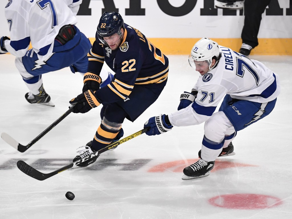 Buffalo Sabres' Johan Larsson (22) and Tampa' Bay Lightning Anthony Cirelli (71) go after the puck during an NHL hockey game in Globen Arena, Stockhol...