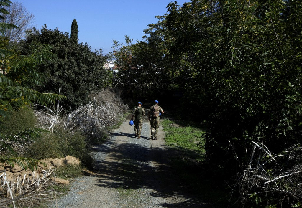 In this photo taken on Tuesday Nov. 5, 2019, a U.N peacekeepers walk inside the U.N buffer zone that divides the Greek Cypriot south and the Turkish C...