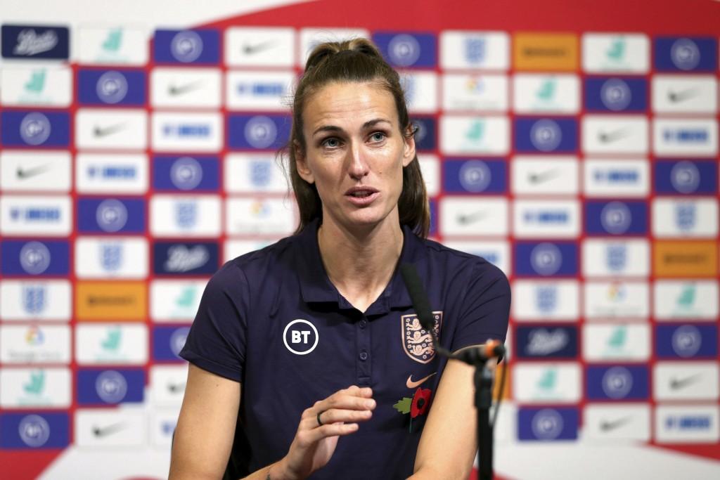 England's Jill Scott speaks during the press conference at Wembley Stadium, London, Friday Nov. 8, 2019. Returning to play at Wembley Stadium for a th...