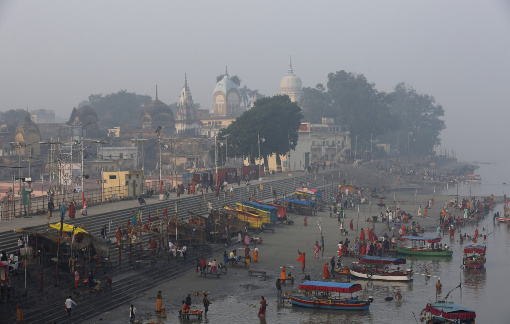 Hindu pilgrims gather by the banks of the River Sarayu to perform morning rituals in Ayodhya, India , Saturday, Nov. 9, 2019. India's security forces ...