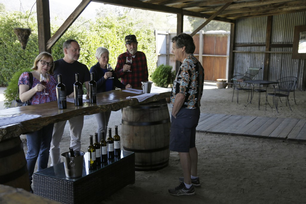 In this Wednesday, Nov. 6, 2019 photo, Mark Dankowski, right, leads a tasting for a group of people visiting the Soda Rock Winery in Healdsburg, Calif...