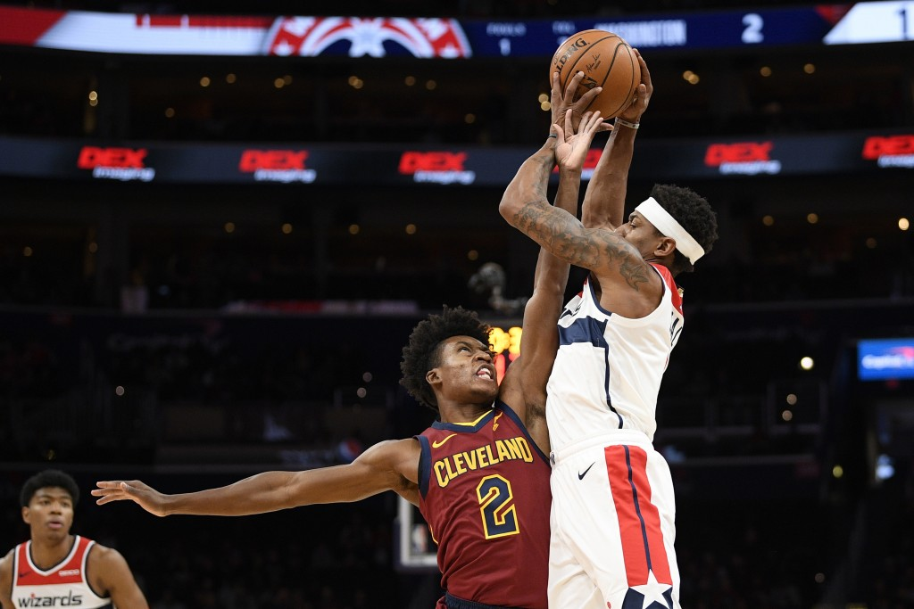Cleveland Cavaliers guard Collin Sexton (2) fouls Washington Wizards guard Bradley Beal, right, during the first half of an NBA basketball game, Frida...