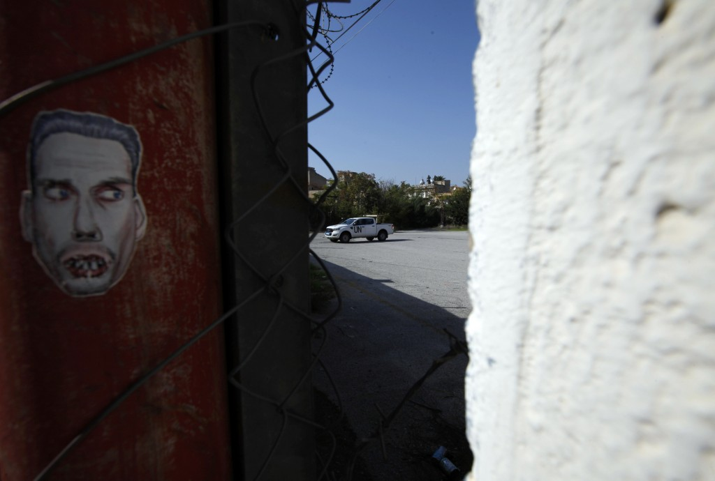 In this photo taken on Wednesday Nov. 6, 2019, a U.N vehicle is seen inside the buffer zone between the Greek Cypriot south and the Turkish Cypriot no...