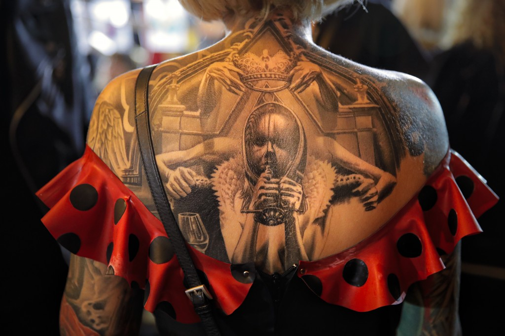 In this Saturday, Nov. 2, 2019, a tattoo decorates a woman's back during the 10th International Tattoo Convention in Bucharest, Romania. The three-day...