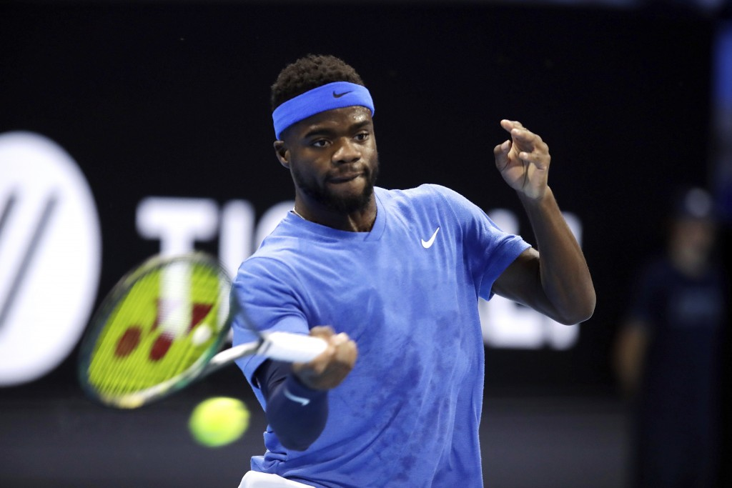 Frances Tiafoe of the United States returns the ball to Alex De Minaur of Australia, during their ATP Next Gen tennis tournament semifinal match, in M...