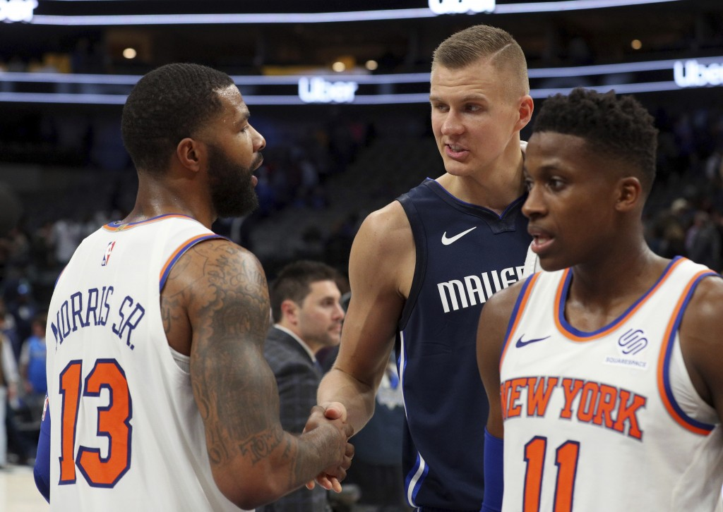 New York Knicks forward Marcus Morris (13) shakes hands with Dallas Mavericks forward Kristaps Porzingis (6) after NBA basketball game Friday, Nov. 8,...