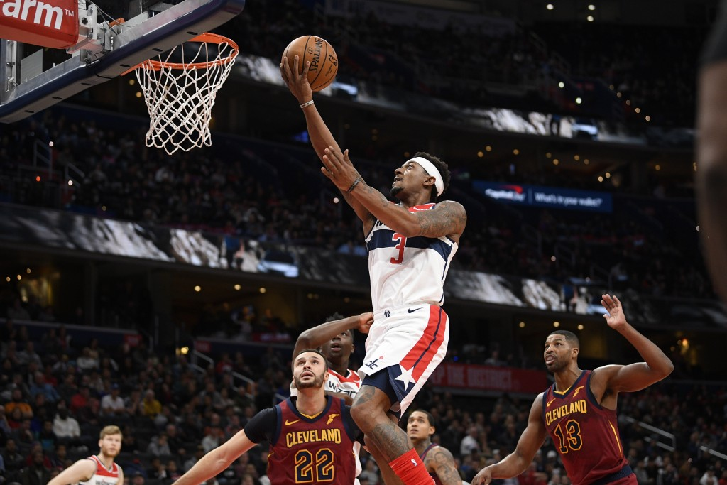 Washington Wizards guard Bradley Beal (3) goes to the basket past Cleveland Cavaliers forward Larry Nance Jr. (22) and center Tristan Thompson (13) du...