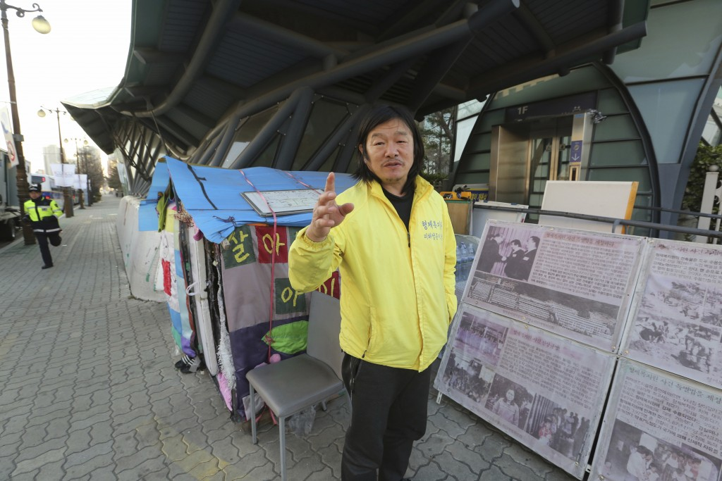 In this April 2, 2019, photo, Choi Seung-woo, a victim of Brothers Home, speaks during an interview in front of National Assembly in Seoul, South Kore...