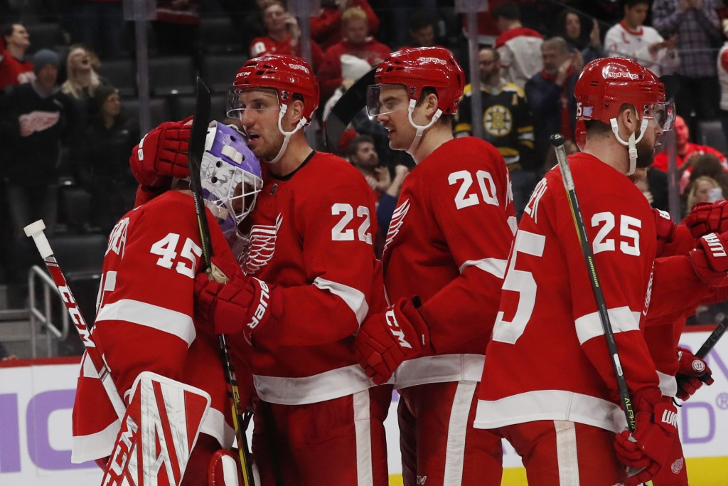 Detroit Red Wings goaltender Jonathan Bernier (45) is hugged by defenseman Patrik Nemeth (22) after their win over the Boston Bruins in an NHL hockey ...