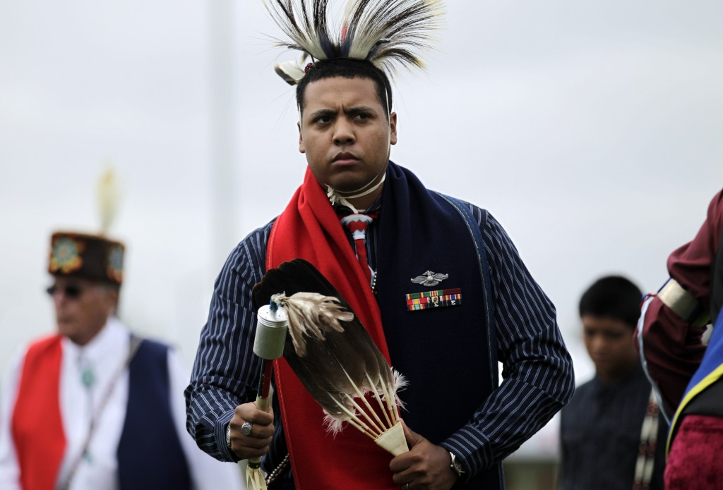 FILE - In this June 15, 2012, file photo, Navy Hospital Corpsman Third Class Kevin Zotigh, of the Kiowa tribe, performs a ceremonial dance as part of ...