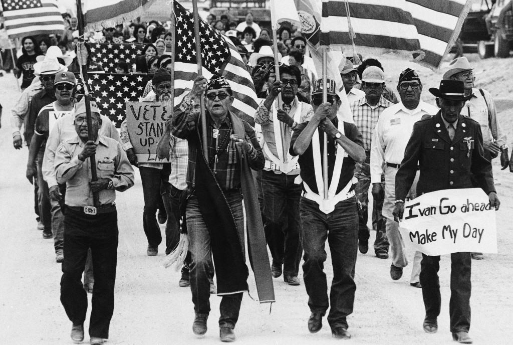 In this July 8, 1986, file photo, World War II Navajo veterans and supporters march through the reservation in a show of solidarity against giving up ...