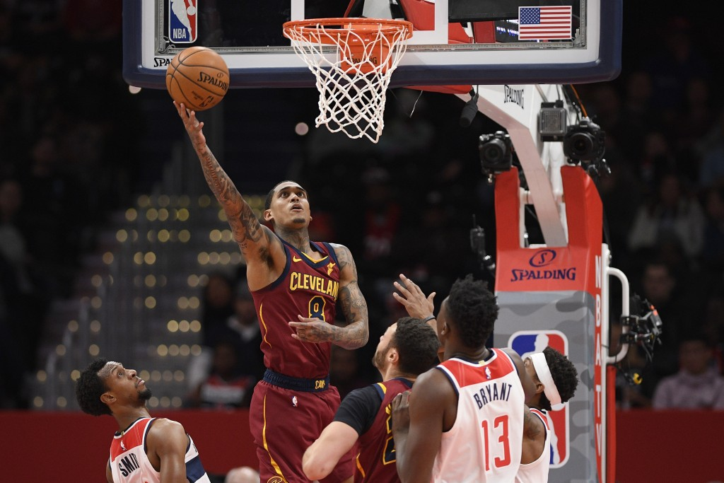 Cleveland Cavaliers guard Jordan Clarkson (8) goes to the basket past Washington Wizards guard Ish Smith, lower left, and center Thomas Bryant (13) du...