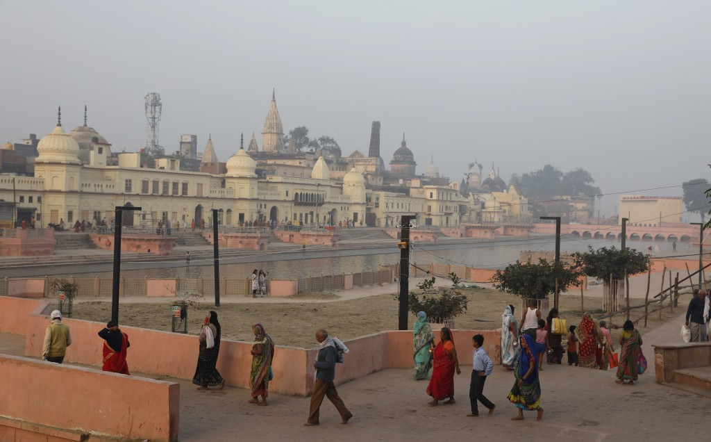 Hindu pilgrims walk by the River Sarayu in Ayodhya, India , Saturday, Nov. 9, 2019. India's security forces were on high alert ahead of the Supreme Co...