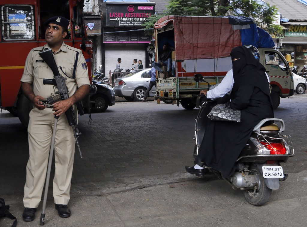 A police officer stands guards on a street in Mumbai, Saturday, Nov. 9, 2019. ndia's security forces were on high alert ahead of the Supreme Court's v...