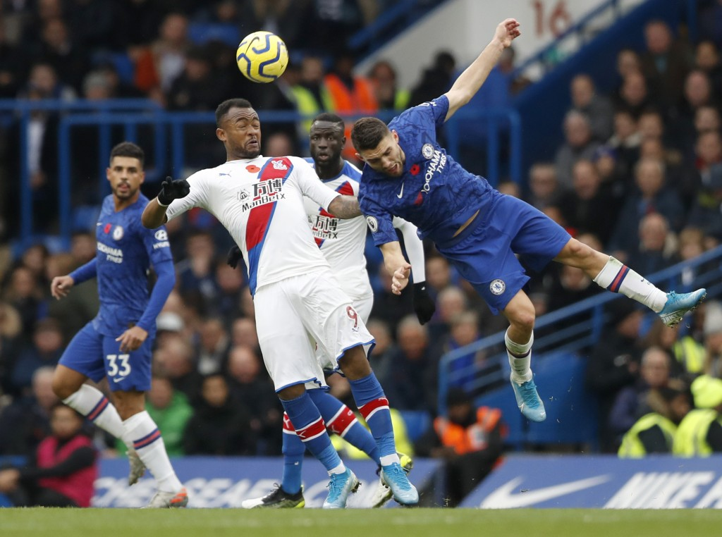 Chelsea's Mateo Kovacic, right, challenges Crystal...