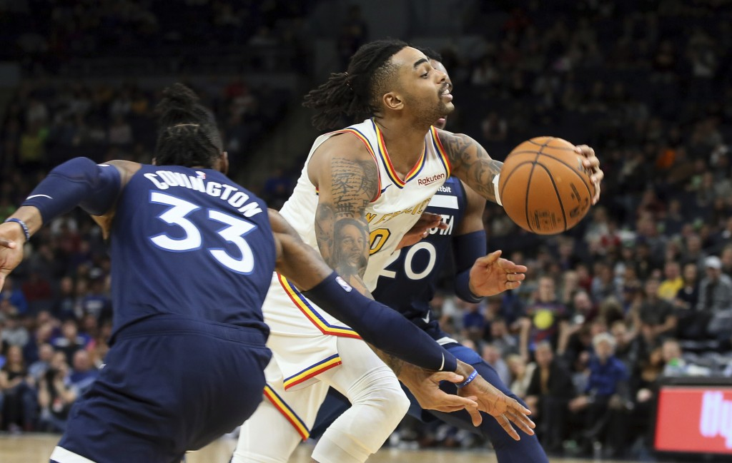 Golden State Warriors' D'Angelo Russell, center, drives between Minnesota Timberwolves' Robert Covington, left, and Josh Okogie, of Nigeria, in the se...