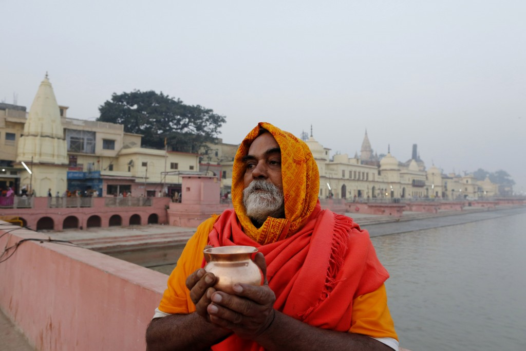 A Sadhu, Hindu holy man, offers prayers in Ayodhya, India , Saturday, Nov. 9, 2019. India's security forces were on high alert ahead of the Supreme Co...