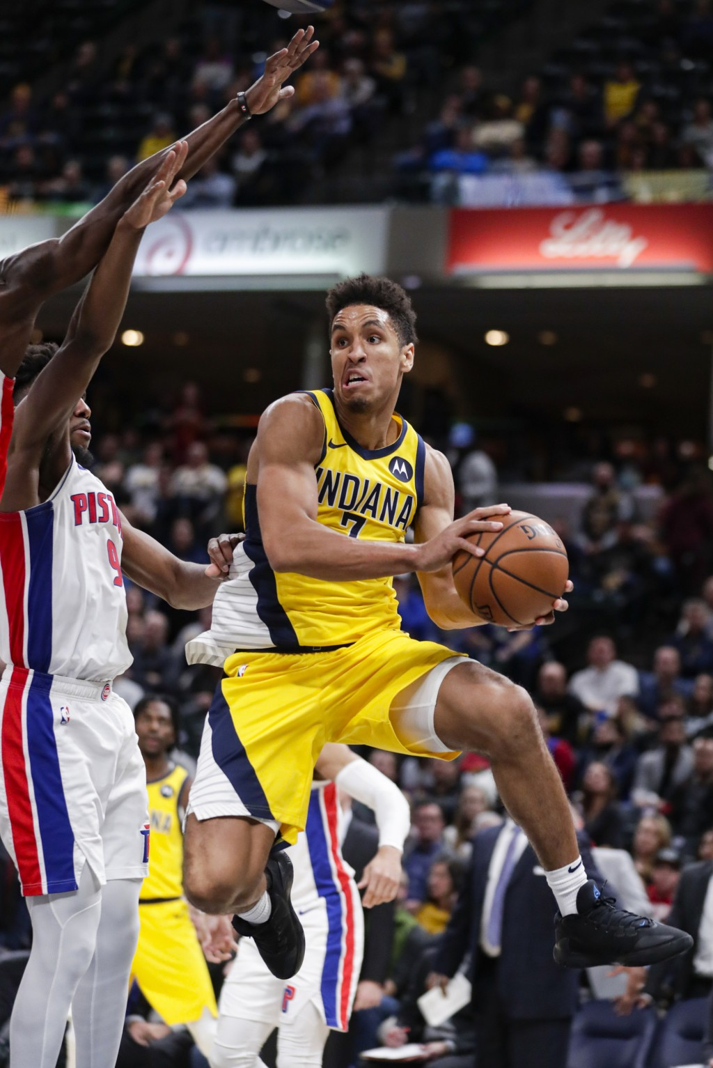 Indiana Pacers guard Malcolm Brogdon (7) looks to pass the ball in front of Detroit Pistons guard Langston Galloway (9) during the second half of an N...