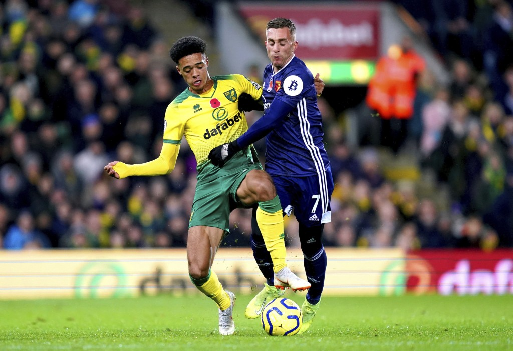Norwich City's Jamal Lewis, left, and Watford's Gerard Deulofeu battle for the ball during the English Premier League soccer match at Carrow Road, Nor...