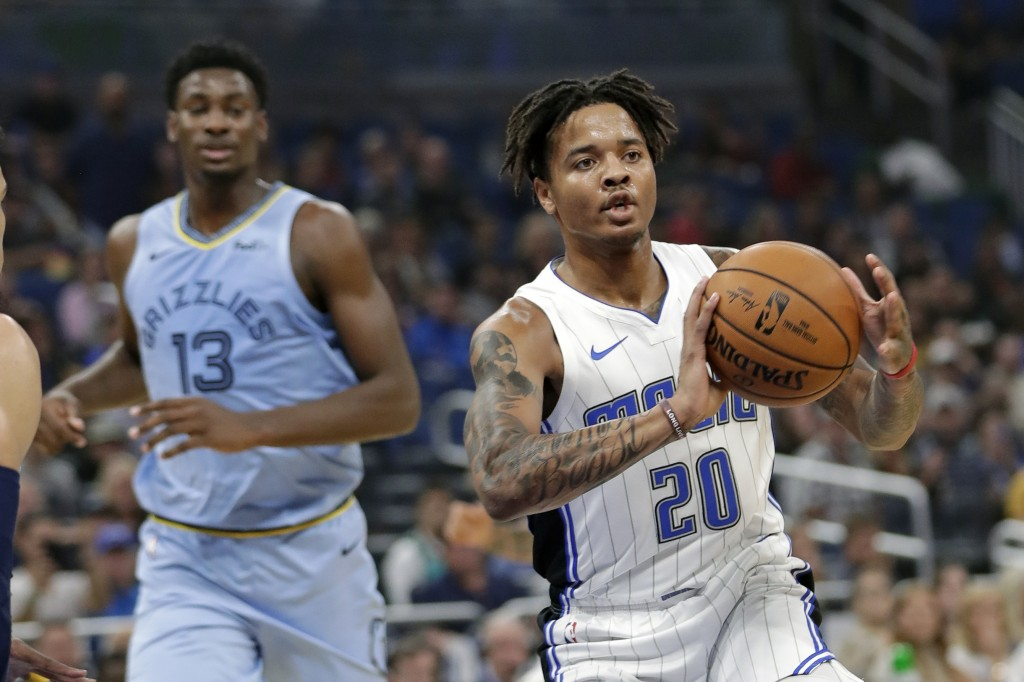 Orlando Magic's Markelle Fultz (20) passes the ball in front of Memphis Grizzlies' Jaren Jackson Jr. (13) during the first half of an NBA basketball g...