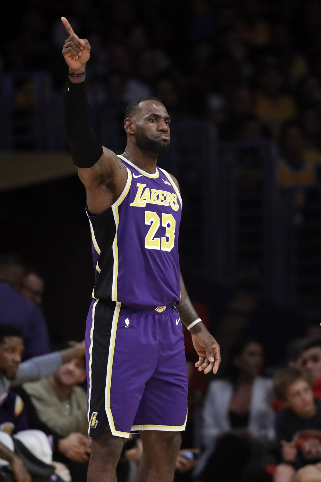 Los Angeles Lakers' LeBron James (23) signals during the first half of the team's NBA basketball game against the Miami Heat on Friday, Nov. 8, 2019, ...
