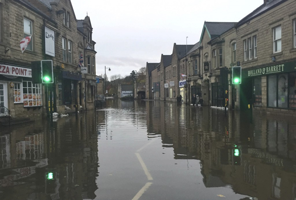 A flooded street in Matlock, northern England, Friday Nov. 8, 2019. Torrential rain drenched parts of north and central England, swelling rivers, forc...