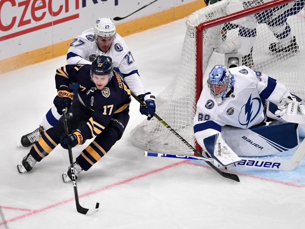 Buffalo Sabres' Vladimir Sobotka (17) works the puck as Tampa Bay Lightning's Ryan McDonagh (27) and goalie Andrei Vasilevskiy defend during an NHL ho...
