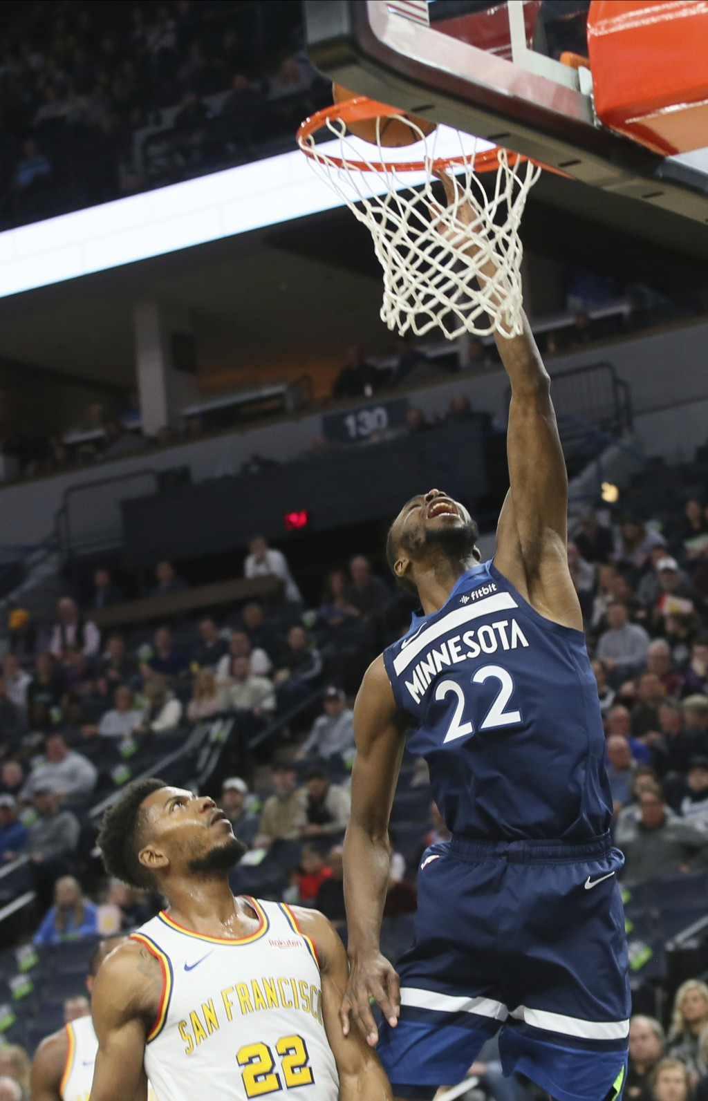 Minnesota Timberwolves' Andrew Wiggins, right, lays up a shot under the watch of Golden State Warriors' Glenn Robinson III in the first half of an NBA...