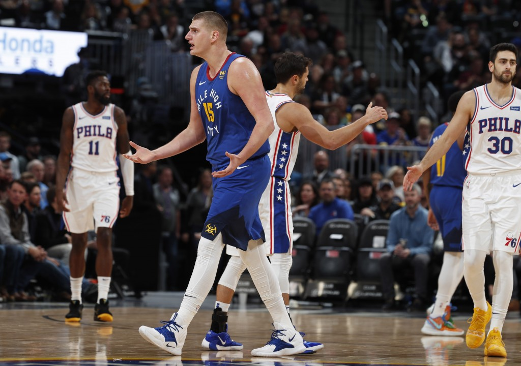 Denver Nuggets center Nikola Jokic argues with a referee for a call against the Philadelphia 76ers before being called for a technical foul of his own...