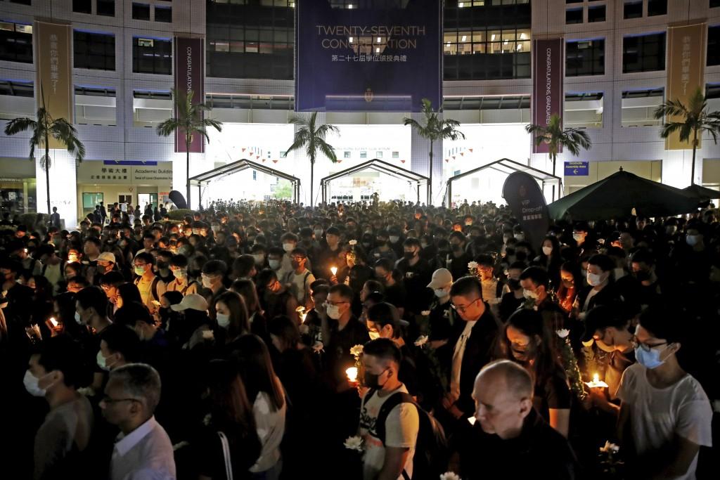 Protesters light candles to pay homage to Chow Tsz-Lok in Hong Kong, early Saturday, Nov. 9, 2019. Chow Tsz-Lok, a Hong Kong university student who fe...