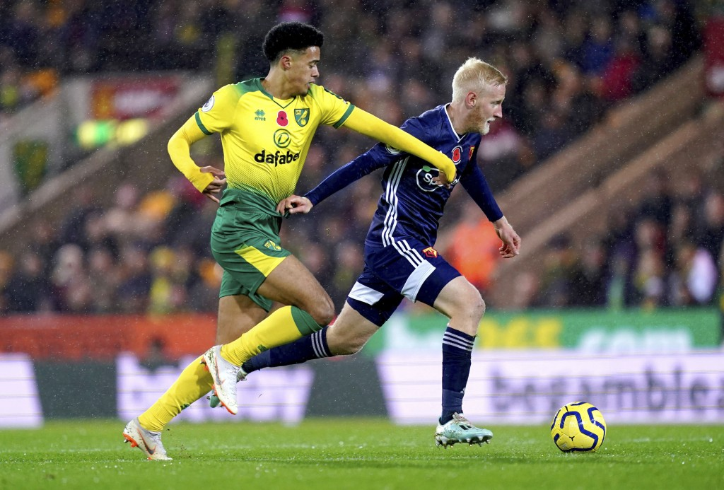 Norwich City's Jamal Lewis, left, and Watford's Will Hughes battle for the ball during the English Premier League soccer match at Carrow Road, Norwich...