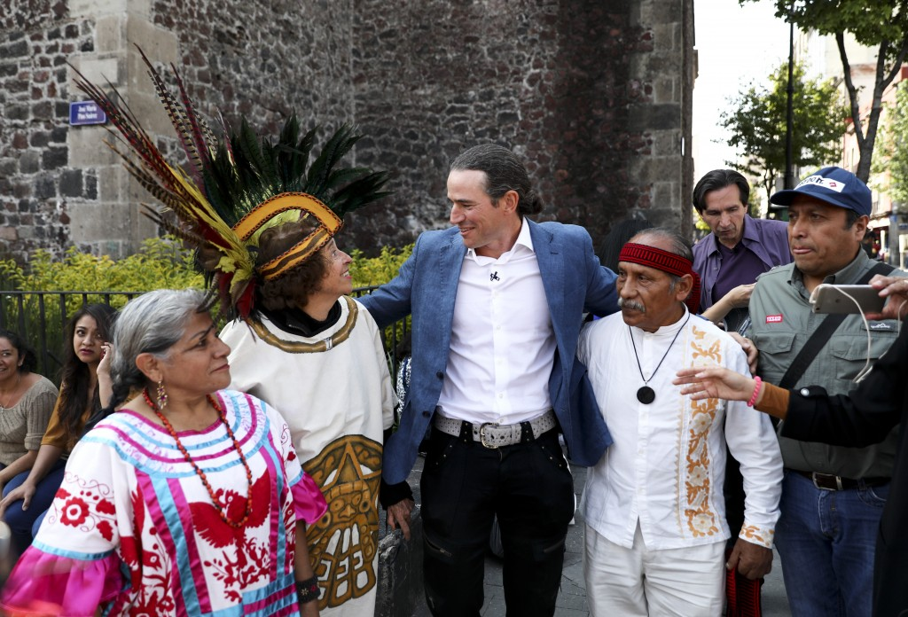 Italian Ascanio Pignatelli of the 16th generation descended from Hernan Cortes' daughter, poses for a picture with Aztec dancers in Mexico City, Frida...