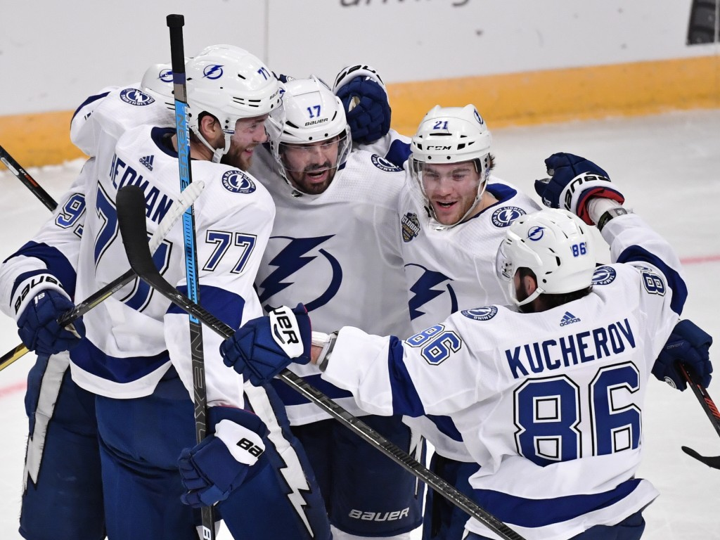 Tampa Bay Lightning's Victor Hedman (77). Alex Killorn (17) and Nikita Kucherov (86) celebrate after an NHL hockey game against the Buffalo Sabres in ...