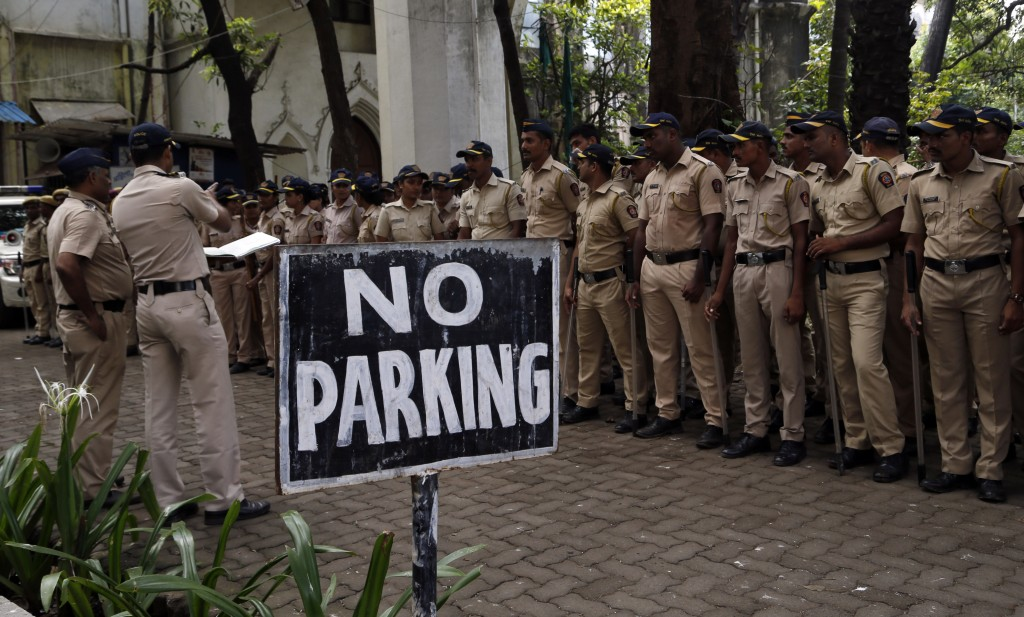 A police officer gives instructions in Mumbai, Saturday, Nov. 9, 2019. ndia's security forces were on high alert ahead of the Supreme Court's verdict ...