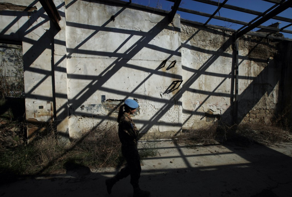 In this photo taken on Tuesday Nov. 5, 2019, a U.N peacekeeper walks inside the U.N buffer zone that divides the Greek Cypriot south and the Turkish C...