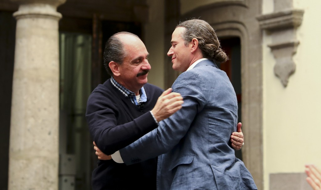 Federico Acosta, a Mexican who traces his lineage back 16 generations back to Moctezuma's daughter, left, embraces Italian Ascanio Pignatelli also of ...