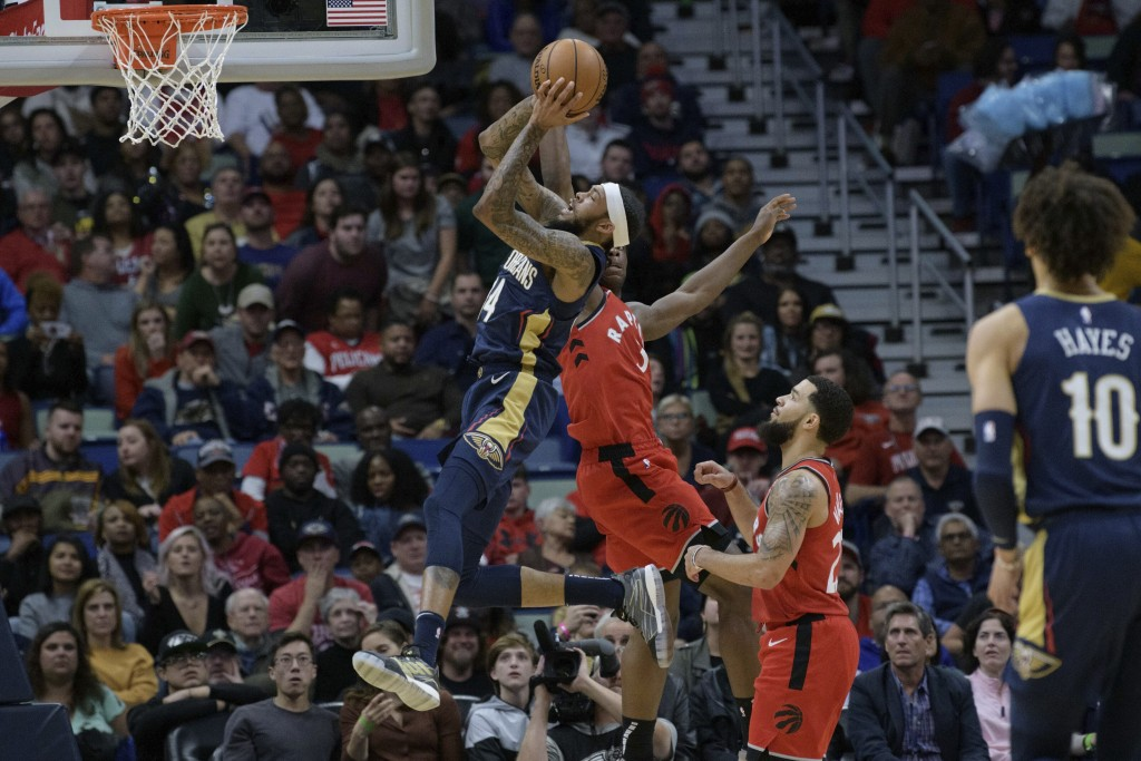 New Orleans Pelicans forward Brandon Ingram (14) shoots next to Toronto Raptors forward OG Anunoby (3) during the first half of an NBA basketball game...