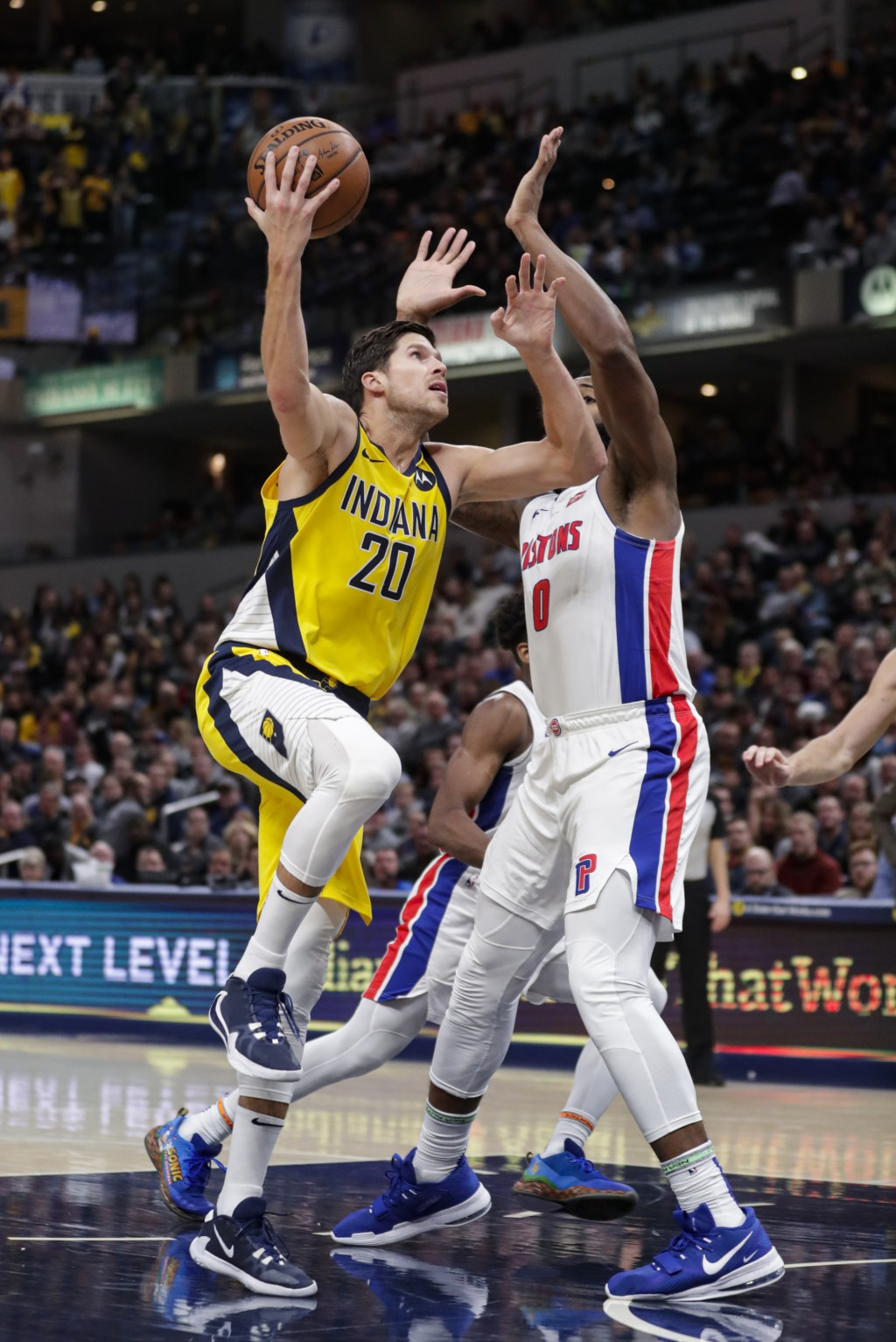 Indiana Pacers forward Doug McDermott (20) shoots over Detroit Pistons center Andre Drummond (0) during the second half of an NBA basketball game in I...