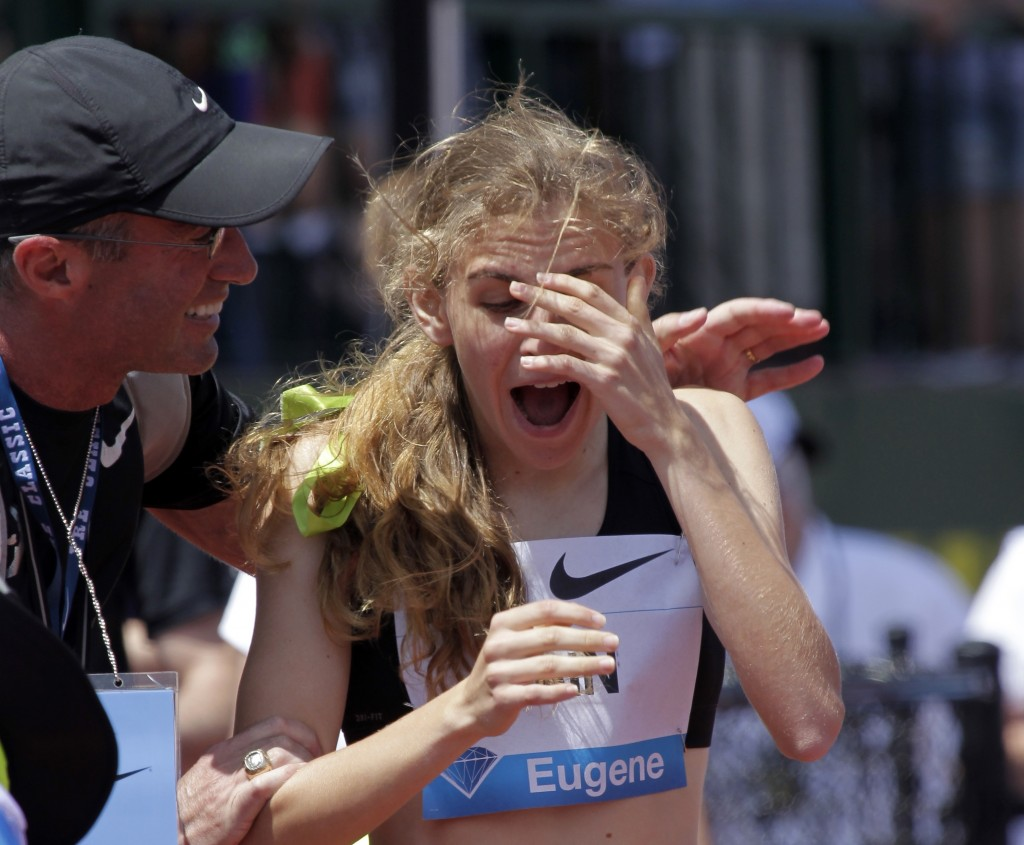 FILE - In this June 1, 2013, file photo, Mary Cain, 17, right, reacts as coach Alberto Salazar tells her she has just broken the American high school ...