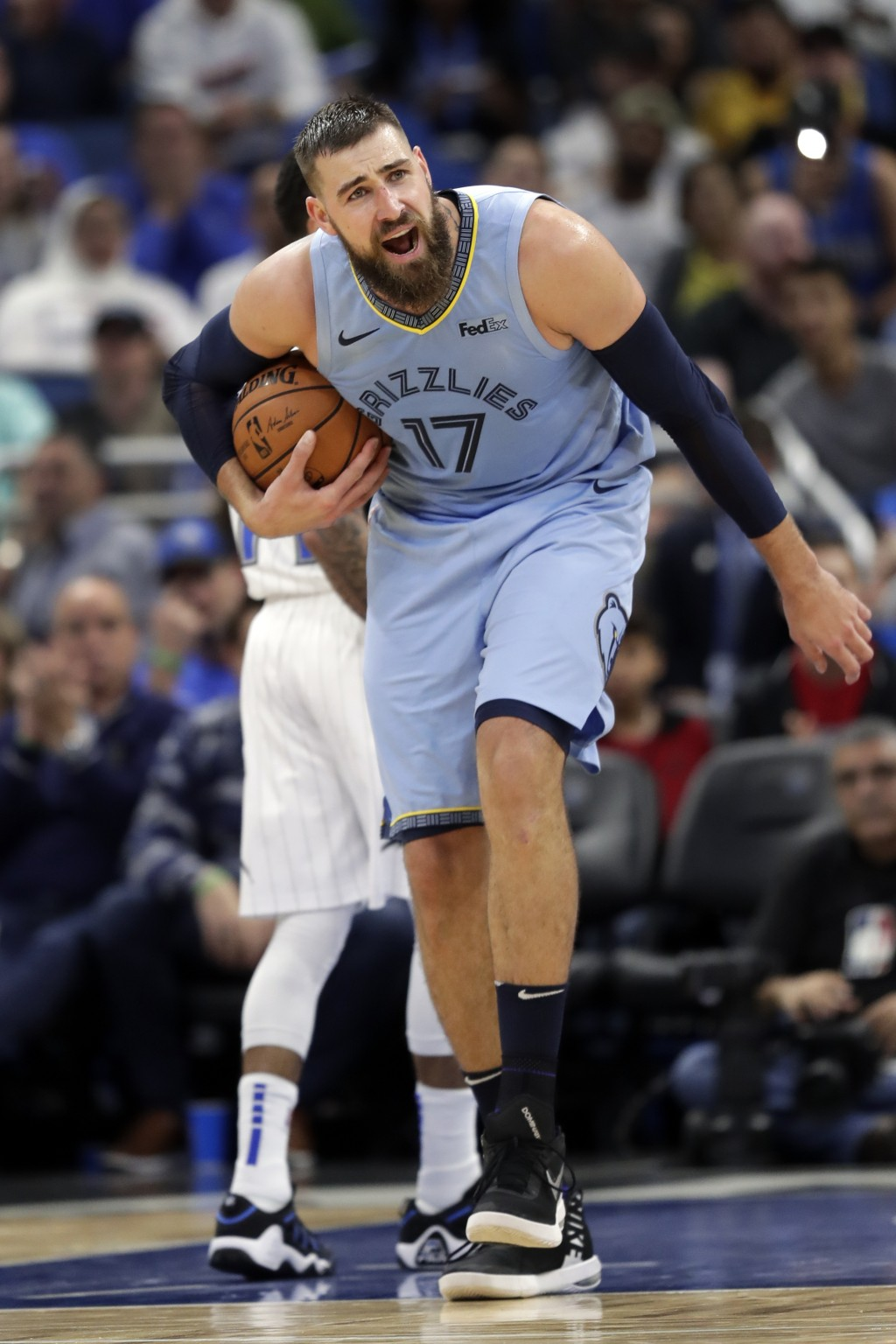 Memphis Grizzlies' Jonas Valanciunas (17) reacts to an official after he was called for traveling during the first half of an NBA basketball game agai...