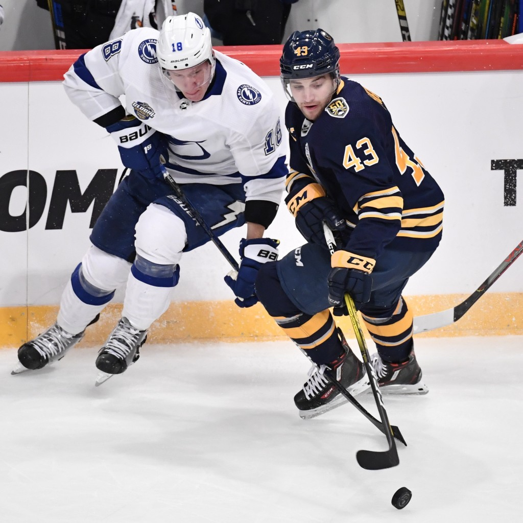 Tampa Bay Lightning's Ondrej Palat, left, and Buffalo Sabres' Conor Sheary (43) battle for the puck during an NHL hockey game in Globen Arena, Stockho...