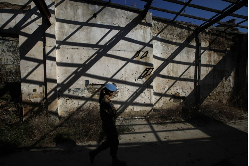 In this Tuesday Nov. 5, 2019, a U.N peacekeeper walks nside the U.N buffer zone that divided the Greek Cypriot south to the Turkish Cypriots north in ...