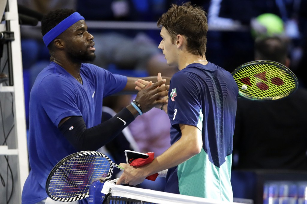 Alex De Minaur, of Australia, right, is congratulated by Frances Tiafoe, of the United States, after winning the ATP Next Gen tennis tournament semifi...