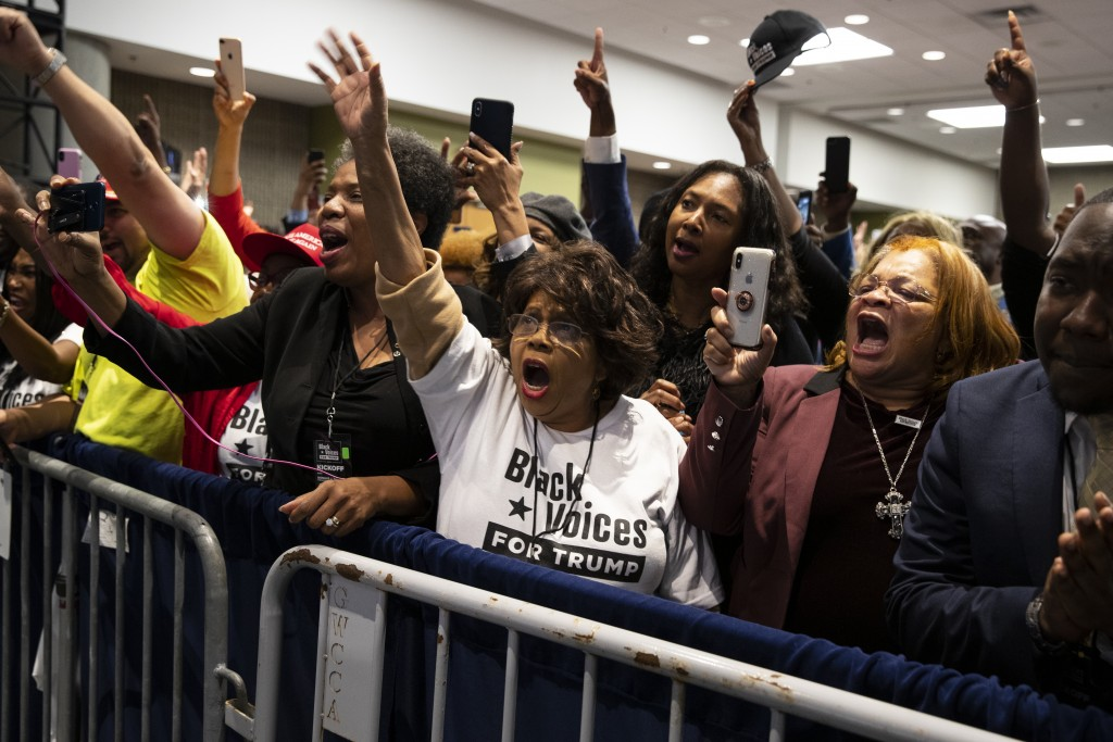 """Supporters of President Donald Trump cheer as he arrives to speak during the launch of """"Black Voices for Trump,"""" at the Georgia World Congress Center,..."""