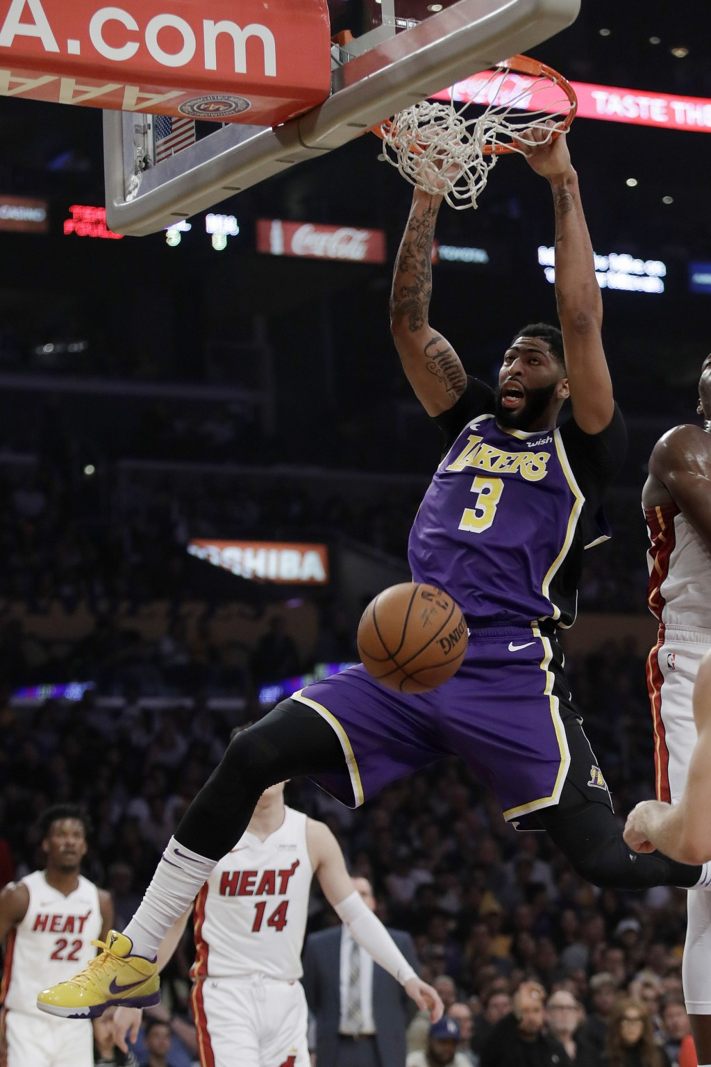 Los Angeles Lakers' Anthony Davis (3) dunks against the Miami Heat during the first half of an NBA basketball game Friday, Nov. 8, 2019, in Los Angele...