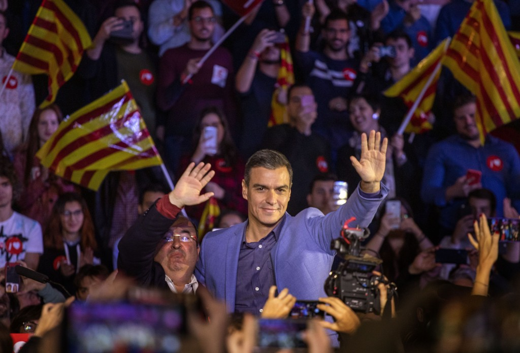 Socialist candidate Pedro Sanchez waves to support...