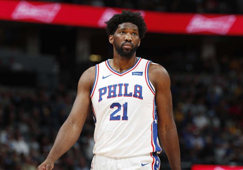Philadelphia 76ers center Joel Embiid looks to the bench during a break in the first half of an NBA basketball game against the Denver Nuggets, Friday...