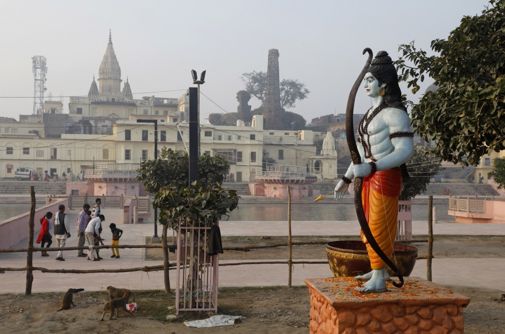 A statue of Hindu god Rama stands beside the River Sarayu in Ayodhya, India , Saturday, Nov. 9, 2019. India's security forces were on high alert ahead...