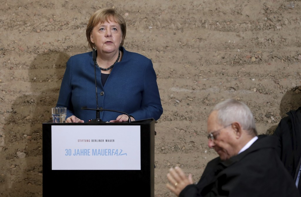 German Chancellor Angela Merkel delivers a speech during a memorial service in the chapel at the Berlin Wall Memorial in Berlin, Germany, Saturday, No...