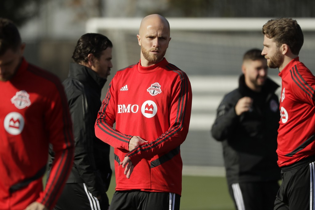 Toronto FC midfielder Michael Bradley, center, stands on the pitch with teammates during a training session Friday, Nov. 8, 2019, in Tukwila, Wash. To...